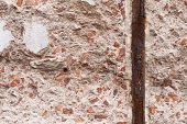 Background: Concrete with Red and Orange Stone