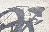 Shadow of Bicycle on Sidewalk