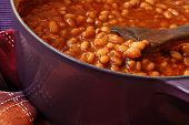 Bubbly hot baked beans (brown sugar recipe) right out of the oven.  Closeup with shallow dof.