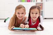 Little girls using tablet computer as art board - painting together