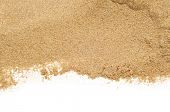 stock photo of sunbathing  - closeup of a pile of sand of a beach or a desert on a white background - JPG