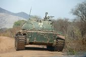 stock photo of north sudan  - northern army tank in road in south sudan - JPG