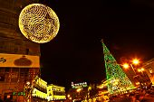 People Have Fun In Christmas Time Passing The Famous Illuminated Christmas Tree At Puerta Del Sol