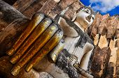 stock photo of chums  - Sitting Buddha with golden hand in Wat Si Chum temple Sukhothai Thailand - JPG