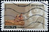 A stamp printed in France dedicated to ancient Etruscans shows coffin burial of spouses