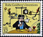 stamp printed in USA dedicated to comic strip classics shows Rube Goldbergs Inventions