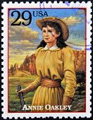 Stamp printed in USA shows Annie Oakley American sharpshooter and exhibition shooter in old west