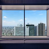 Aerial View Of Shinjuku Skyscrapers Through A Window Frame. Tokyo, Japan.