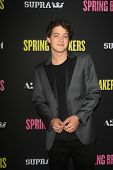 LOS ANGELES - MAR 14:  Israel Broussard arrives at the 'Spring Breakers