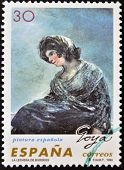 A stamp printed in spain shows The Milkmaid of Bordeaux by Francisco de Goya