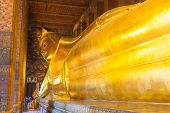 BANGKOK - MARCH 16. Reclining Buddha in Wat Pho temple on March 16, 2012 in Bangkok, Thailand. Wat P