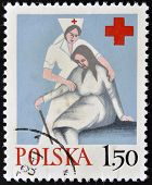 POLAND - CIRCA 1970: A stamp printed in Poland shows medical sister helps the elderly woman