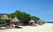 South Sea Island Beach & Umbrellas, Fiji.