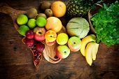 pic of exotic_food  - Organic Fruit variety on wood - JPG