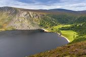 stock photo of guinness  - Guinness Lake in Wicklow Mountains in Ireland - JPG