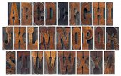 alphabet in vintage letterpress wood type blocks, French Clarendon font popular in western movies and memorabilia, a collage of 26 isolated letters
