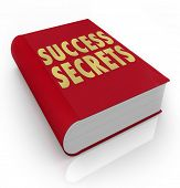 The words Success Secrets on a red book to serve as an instruction manual on how to be successful in