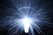 stock photo of shooting star  - a burst of light from a fibre - JPG