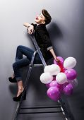 Pretty Cheerful Fashion Retro Teen Girl Laughing On Ladder