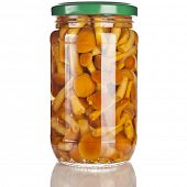 Mushrooms marinaded (agaric honey) in glass jar close up isolated on a white background