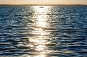 Sun Track And Fishing Boat On Lake Surface.