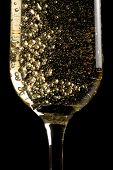 Flute Of Champagne With Golden Bubbles