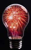 foto of firework display  - Creative Explosion as a fireworks display celebration represented by exploding sparks of color in the shape of a light bulb on black as a concept of innovation and creative power - JPG