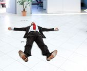 Portrait of a businessman lying on the floor