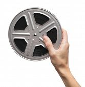 Motion picture film reel in man's hand
