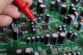 stock photo of capacitor  - Electronics Repair service close - JPG