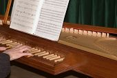 Playing The Clavecin