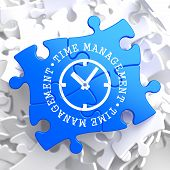 Time Management Concept on Blue Puzzle.