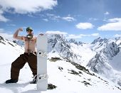 Snowboarder In Mountains Of Caucasus
