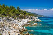 Rocky coastline and a beautiful clear water at Halkidiki Kassandra peninsula in Greece