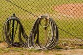 Hoses At Baseball Field