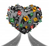 stock photo of struggle  - Relationship advice guidance and love counseling concept with a group of tangled roads shaped as a heart with confusing traffic signs as a metaphor for problems in intimate relations and romantic struggle on white - JPG