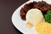 pic of brazilian food  - Brazilian Feijoada closeup on a brown background - JPG