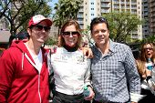 LOS ANGELES - APR 12:  Michael Trucco, Tricia Helfer, Guest at the Long Beach Grand Prix Pro/Celeb Race Day at the Long Beach Grand Prix Race Circuit on April 12, 2014 in Long Beach, CA