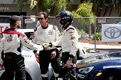 LOS ANGELES - APR 12:  Max Thieriot, Adrien Brody, Phil Keoghan at the Long Beach Grand Prix Pro/Cel