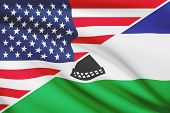 Series Of Ruffled Flags. Usa And Kingdom Of Lesotho.