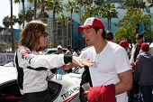 LOS ANGELES - APR 12:  Tricia Helfer, Michael Trucco at the Long Beach Grand Prix Pro/Celeb Race Day