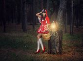 Beautiful Girl In A Red Raincoat Alone In The Woods.