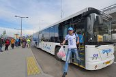 SOCHI, RUSSIA - FEBRUARY 14, 2014: Fan exiting the bus arrived from Sochi to Adler during XXII Winte