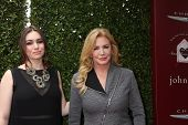 LOS ANGELES - APR 13:  Sophie Simmons, Shannon Tweed at the John Varvatos 11th Annual Stuart House B