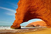 Red archs on atlantic ocean coast. Morocco, Africa