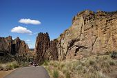 Hikers Drop Into The Canyon Of The Crooked River