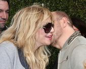 LOS ANGELES - APR 13:  Courtney Love, John Varvatos at the John Varvatos 11th Annual Stuart House Be