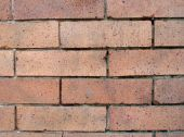 stock photo of soma  - Detail reddish brick with spots and mortar facade from a building in San Francisco SOMA area - JPG