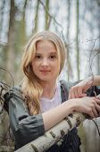 Picture Of Beautiful Girl Touching Birch Branches And Smiling