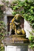 stock photo of garden sculpture  - The sculpture of the child with the dog in the garden of the castle in Montresor - JPG